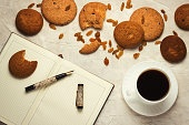 Cup with Black Coffee, Cookies, Diary and Pen on the Light Background