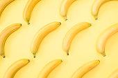 Yellow bananas on a yellow background. Fresh delicious flavored natural bananas.
