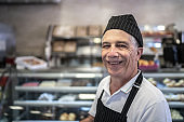 Portrait of a happy bakery's employee working