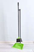 Fastened dustpan and brush for cleaning floor from dust and trash.
