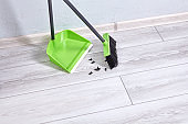 Plastic brush and dustpan clean flat from dust and dirt.