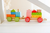 Toy locomotives trailers loaded with colored material
