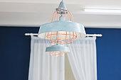blue ceiling aluminum lamp. close-up