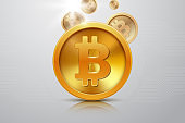 Golden bitcoin with falling coins on abstract background