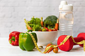 Diet Health Plan. Workout planning. Sport exercise equipment workout andgym background with nutrition fresh salad
