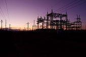 Vivid sunset backlight electrical power station.