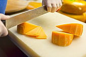 Hands Slicing Cheese
