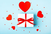 Attractive gift on the blue background