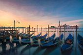 Venice lagoon, San Giorgio church and gondolas at sunrise. Italy