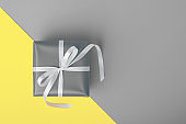 Attractive gift on the yellow and gray background