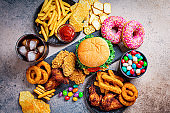 Fast food assortment. Junk food concept. Unhealthy food for the heart, teeth, skin, figure.