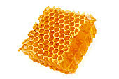 Healing wild honeycomb isolated on white background. Sweet natural and healthy delicacy. Propolis, beeswax and honey