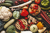 Ripe autumn vegetables on a wooden table, cooking of healthy food