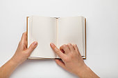 A5 open book mockup with hands. Empty template of page. Blank for design. Isolated on white background