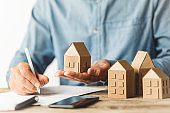 Considering buying a home, investing in real estate. Broker signs a sales agreement