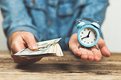 Time and money in hand. Salary per hour of work, income and profit