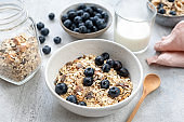 Breakfast cereals in bowl served with almond milk