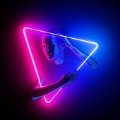 3d render, woman portrait inside triangular pink blue neon frame, mannequin body parts, ultraviolet light glowing ring. Bald head, beautiful female face, hands. Minimal fashion concept