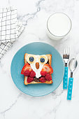 Breakfast toast for kids shaped as cute funny owl