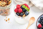 Yogurt with berries and granola in jar