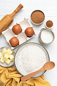 Ingredients for baking on white wooden table
