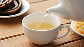 Pouring green tea in cup