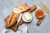 Bread, butter and honey still life