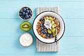 Oat honey granola with berries, kiwi and greek yogurt