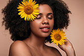 Black woman with sunflowers in hair