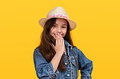 Giggling teen girl covering mouth