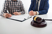 Law, advice and Legal services concept. Lawyer and attorney having team meeting at law firm.