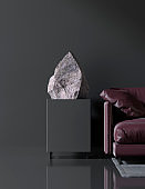 dark interior in a modern style with a stone on the pedestal, exhibition