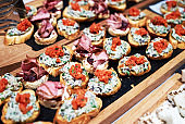 Canapes and appetizers on a table, close up. Catering service buffet
