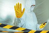 Epidemiologist using smartphone in hospital virus infection quarantine