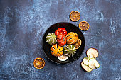Flat lay top down image of dried seasonal Winter fruit on textured rough background