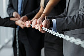 Business team pulling chain