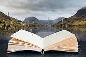 Conceptual composite open book image of Beautiful Autumn Fall landscape image of Lake Buttermere in Lake District England