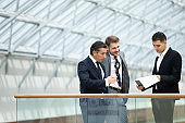 Business people discuss documents