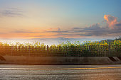 A photo of the road with sunset. landscape in the summer time in Thailand
