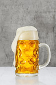 Beer splash in glass on vintage background with copy space