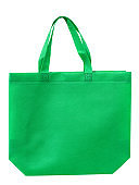 green cloth shopping bag isolated on white background