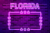 Florida US State glowing purple neon lettering and a rectangular frame with stars