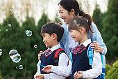 The children blow bubbles