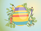 Easter concept vector illustration, cartoon flat tiny happy people decorating Easter eggs, preparing decoration for spring holiday