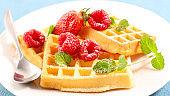 waffle with raspberry, mint leaf and sugar powder