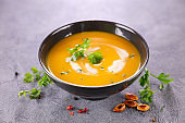 pumpkin soup with herbs and cream