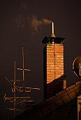 Bricked chimney against dark sky