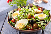 vegetable salad with egg, potato,tomato and olive