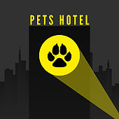 Pets hotel. Trail of dogs paw in spotlight on city background. Logo for pet hotel. vector