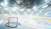 Hockey stadium at night. Arena illuminated by spotlights. Empty sport rink. Hockey stadium at night under the moonlight. Empty field. Wide angle